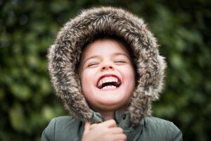 Smiling child wearing winter coat